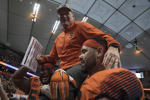 Scott Shafer is carried off the field in his last game as head coach. He finished his tenure 14-23.