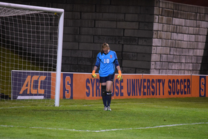 Courtney Brosnan suffered an injury during the game, but still made six saves and kept SU competitive.