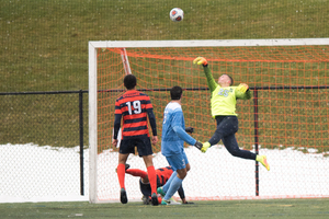 Hendrik Hilpert makes one of his eight saves in SU's Sweet 16 matchup against North Carolina.
