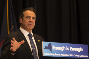 Gov. Andrew Cuomo signed legislation on Monday raising the age of criminal responsibility to 18 years old.