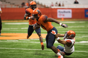 The Syracuse football team offered a glimpse, though short, of what the 2017 unit will look like. Here, Dontae Strickland works to break free of a tackle.