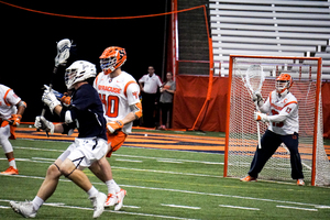 Syracuse redshirt senior goalie Evan Molloy came up with 15 saves to salvage SU's poor performance at the faceoff X.