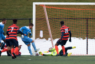 Hilpert dives on the ground as the Tar Heels pressure inside the box.
