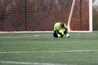 Hilpert sits alone on the field after the game. Allowing just one goal wasn't good enough on Sunday.