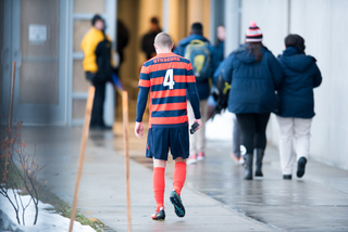 Senior Liam Callahan walks into the locker room at Onondaga Community College's Murphy Field. Sunday marked the final game in his college career.